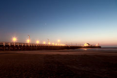 Pier. In Blankenberge Belgium in the evening nightfall planets jupiter and venus are visible Stock Images