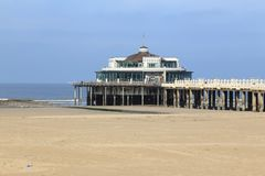 Pier of Blankenberge in Belgium. Side view from the beach royalty free stock image