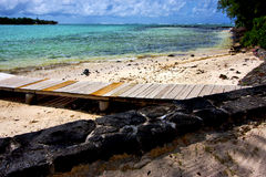 Pier blue bay foam footstep indian ocean. Some stone in the island of deus cocos in mauritius Royalty Free Stock Images