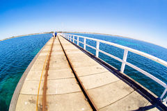 Pier in blue ocean water with fisheye horison Stock Photography