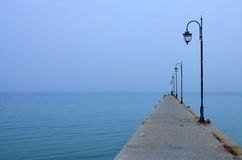 Pier in the blue sea. Royalty Free Stock Photo