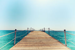Pier in blue sea vintage toning Royalty Free Stock Photography