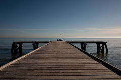 Pier on the blue sky. Pier on the background blue sky and sea Stock Photo