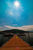 Pier and boat on Lake Maggiore Stock Images