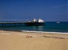 Pier and boat on Malibu beach. Pier on Malibu beach, California Stock Photography