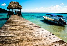 Pier an a Boat near a Lake. In Guatemala Stock Photos