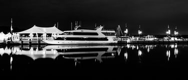 Pier and boat reflecting in the Potomac River at night, in Natio Stock Photography