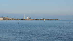 Pier with a boat. Sea on the horizon that pier with a boat moored to it stock footage