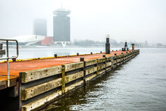 Pier of boat station in foggy day. Stock Photography