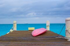 Pier with boat on a tropical beach Royalty Free Stock Image