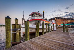 Pier and boat on the waterfront, in Annapolis, Maryland. stock photo
