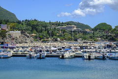 Pier with boats on the island Corfu, Greece. royalty free stock photography