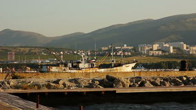 Pier With Boats at Morning. Mountain Background. At Seaside stock video footage