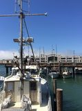 Pier with the boats in San Francisco on a sunny day royalty free stock photography