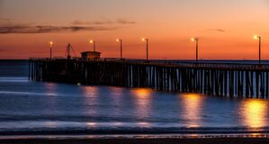 Pier, Body Of Water, Horizon, Sunset Royalty Free Stock Photo
