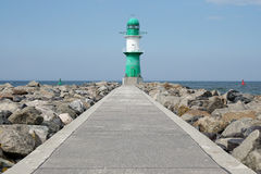Pier with breakwater light or beacon Stock Images