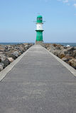 Pier with breakwater light or beacon Stock Photo