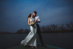 Pier bride groom night Royalty Free Stock Images