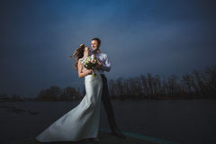 Pier bride groom night. Sky Stock Images
