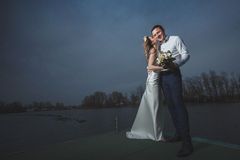 Pier bride groom night Stock Photography