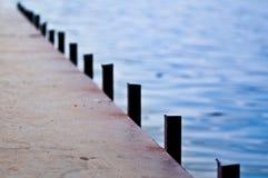 Pier bridge. Metal pier bridge over blue calm water Stock Photography