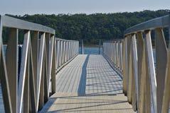 Pier bridge with silver gate royalty free stock photos