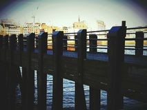 Pier bridge wooden architecture object. Water river Thames city centre Stock Photography