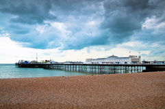 Pier of Brighton. Amusement pier and boardwalk of Brighton in England royalty free stock image