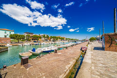 Pier with buildings and boats Stock Photos