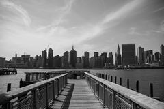 Pier and buildings of Manhattan in black and white style Royalty Free Stock Images
