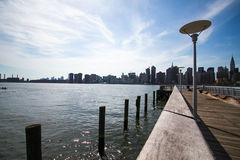 Pier and buildings in Manhattan, New York Royalty Free Stock Images