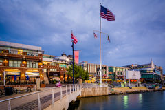 Pier and buildings at twilight, along the Potomac River, in National Harbor, Maryland. royalty free stock photos