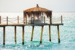 Pier with a bungalow Stock Photo