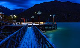Pier and pier of Caleta Tortel. Night landscape of the pier and pier of Caleta Tortel. With its cypress walkways of the Gulettes of Caleta Tortel. Austral road stock images