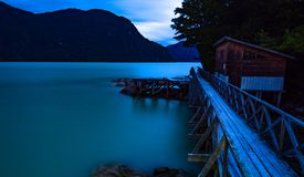 Pier of Caleta Tortel. Night landscape of the pier and pier of Caleta Tortel. With its cypress walkways of the Gulettes of Caleta Tortel. Austral road. Chili stock images