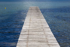 Pier into the calm sea. Pier into the calm blue sea Stock Photography