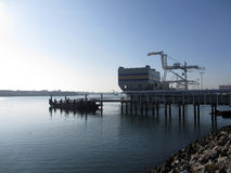 Pier and Cargo Boat Sits in Oakland Harbor Royalty Free Stock Photos