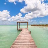 Pier in Caribbean Bacalar lagoon, Quintana Roo, Mexico. Peaceful pier in the Mayan lagoon area called Bacalar, Quintana Roo, Mexico Stock Photography