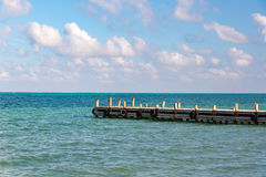 Pier and Caribbean Sea. View of a pier extending out into the Caribbean Sea in Punta Allen in the Sian Kaan Biosphere Reserve near Tulum, Mexico Stock Image