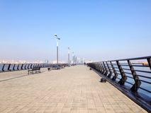 Pier at the Caspian Sea. With skyline of Baku, Azerbaijan royalty free stock photography