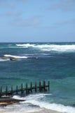Pier choppy seas Royalty Free Stock Image