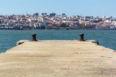 Pier with city on the background.  royalty free stock photography