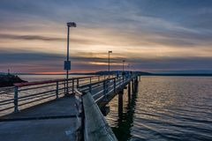 Pier And Cloudy Sunset 3 Immagine Stock