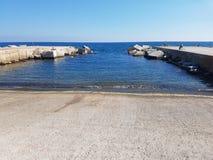 Pier on the coastline of Mediterranean Sea in Barcelona, Spain stock images