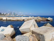 Pier on the coastline of Mediterranean Sea in Barcelona, Spain Stock Photo