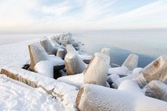 Pier concrete blocks covered with ice Stock Photography