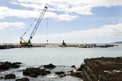 Pier construction. Heavy crane in a pier construction site Royalty Free Stock Photos
