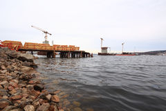 Pier construction out in water Stock Image