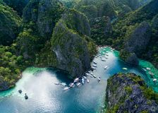 Pier in Coron, Palawan, Philippines. Kayangan Lake in Background. Tour A. royalty free stock photo
