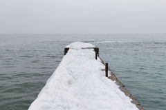 Pier covered with snow Royalty Free Stock Photography